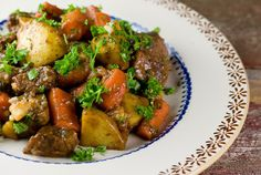Guinness Beef Stew Recipe Main Dishes with roast, pepper, salt, olive oil, onions, tomato paste, flour, beef broth, Guinness Beer, brown sugar, fresh thyme, yukon gold potatoes, carrots, fresh parsley