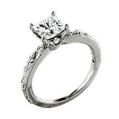 from the Romantique collection by Ritani, platinum four prong engagement ring to accommodate a 1.00 carat princess cut diamond center stone with the finest set micropave diamonds on the setting and bezel set diamonds on the mounting .26 carats total weight, with microscopic hand carved leaf motif on the shank