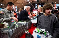 U.S. Vice President Joseph Biden participates during a Unite America in Service event on the National Day of Service as part of the 57th Presidential Inauguration January 19, 2013 at the DC Armory in Washington, DC. Vice President Biden and his family joined volunteers to pack Operation Gratitude care kits filled with necessities for deployed U.S. Service Members, Wounded Warriors, Veterans and First Responders. (Photo: Alex Wong, Getty Images)