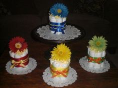 Items similar to Flower Baby Shower Centerpieces Primary colors mini diaper cakes different colors and sizes available too on Etsy Diaper Cake Centerpieces, Baby Shower Centerpieces, Flower Centerpieces, Flower Arrangements, Baby Shower Games, Baby Shower Parties, Baby Boy Shower, Shower Party, Baby Showers