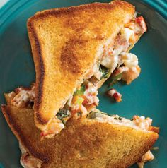 We put a spin on the classic tuna melt sandwich. How about a Lobster Melt? Lobster and arugula leaves are sandwiched between layers of provolone cheese and mascarpone mixed with green onions and tomatoes.