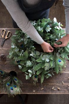 love this contemporary christmas wreath with peacock feathers, eucalyptus and fir by Philippa Craddock. Click through for easy step by steps to creating your own beautiful contemporary fresh natural foliage christmas wreath christmaswreathstomake Natural Christmas, Beautiful Christmas, Christmas Crafts, Christmas Christmas, Christmas Tables, Nordic Christmas, Modern Christmas, Christmas Pictures, Contemporary Christmas Decorations