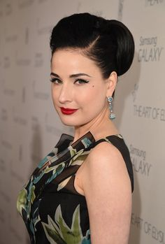Pin for Later: Celebrities Brought Their Beauty Best to These Golden Globes Parties Dita Von Teese Dita paired her signature red lipstick with a retro-inspired bun at the Art of Elysium annual Heaven Gala.