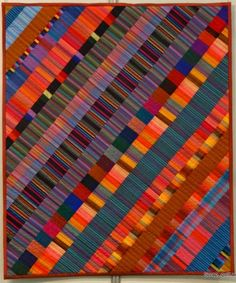 Kaffe Stripes quilt spotted at Quilt en Beujolais 2014. This couldn't be simpler: fabric strips in complementary colors are cut on the WOF and set on a 45-degree angle. Photo by Scrap, Quilt and Stitch