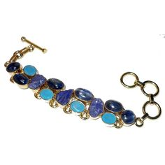Gold-plated Brass Kyanite, Tanzanite and Blue Chalcedony Rough Cut Bracelet https://sitaracollections.com/collections/bracelets-cuffs-and-bangles/products/gold-plated-kyanite-tanzanite-and-blue-chalcedony-bracelet