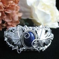 Celtic and magical jewelry, wedding bridal circlets, and torcs by Kelly Graham.