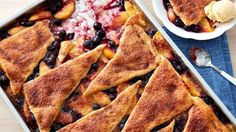 Looking for that perfect summer time dessert to make this weekend they why not try out this Peach-Blueberry Crescent-Topped Sheet-Pan Dessert that has been b Peach Crescent Rolls, Crescent Roll Recipes, Cresent Rolls, Easy Desserts, Dessert Recipes, Fruit Recipes, Yummy Recipes, Snack Recipes, Dessert