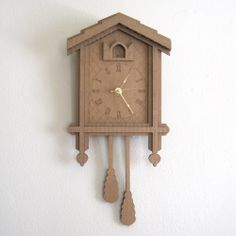Cardboard Cuckoo Clock - Modern Minimal Laser Cut Wall Decor. $38.00, via Etsy.
