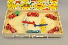 """Arcade Home Defense Set # 6941, Late 1930's, cast iron toy set includes, police and Chief car, two airplanes, two fire trucks, wrecker and dump truck, has interior toy holder. 19 1/4"""" l. x 11 1/2"""" w."""