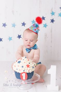 """Boys Star red and blue themed cake smash photo shoot, Preston, Lancashire 'Ollie & George photography studio"""" in the Ribble Valley"""