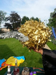 My harry potter party idea catch(break) the snitch piñata only took one day to make and it wouldn't break. Used balloon paper mache process and tissue paper as for the wings very thin cardboard (maruchuan ramen noodle) and lots of glue sticks + my handy dandy glue gun!