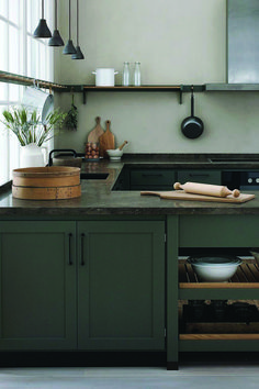 gorgeous kitchen with olive green cabinets, deep earth-colored marble counters, . gorgeous kitchen with olive green cabinets, deep earth-colored marble counters, and natural wood accents interiors Most Popular Green Kitchen Cabinets, Kitchen Cabinet Colors, Kitchen Dining, Kitchen Decor, Kitchen Ideas, Kitchen Corner, Design Kitchen, Kitchens With Dark Cabinets, Kitchen Cabinet Inspiration