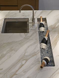 Stunning Carrera marble bespoke kitchen island in Roundhouse Notting Hill showroom