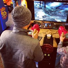 Playing video games at Chucky Cheese