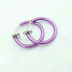 2 NEW PURPLE Faux clip on nose lip septum hoop Brand new. Clips on to any piercing place to make the perfect temporary piercing. Pain free. Great to try out before you decide on a forever piercing. This listing is for 2!! Jewelry Rings