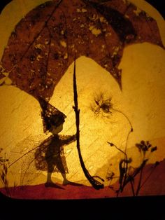 Autumn Transparency. Make something like this for light table with manips. for children to use on top, like people figures, nuts, pinecones, etc.