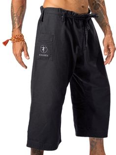 "At last, a yoga pant designed for men.  Inspired by the martial arts Gi, this pant is built tough and constructed with ample room to move.  The extra-large crotch design allows for full range of motion in all asana, even full split if Hanumanasana is called for.  Complete with utility pocket, the YOGiiZA pant, made for men, can be worn in the studio or street where the world can see that you are on the enlightened path.*  Fabric: 100% Organic Cotton *  Waist: 26""-41"" one size fits all…"