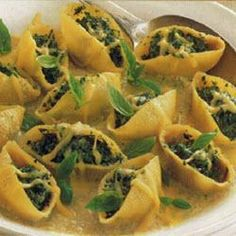 Ingredients Serves:4 1 bunch (350 g) spinach, trimmed and rinsed 3 medium zucchini, thinly sliced 4 cloves garlic, finely chopped 420 ml vegetable stock 260 g ricotta cheese 100 g coarsely chopped walnuts 20 g grated parmesan cheese 3 tablespoons each chopped marjoram, chives and basil 1 medium egg, lightly beaten 12 giant pasta shells, cooked al dente 60 g edam cheese, grated Directions Prep:45min › Cook:40min › Ready in:1hr25min Place spinach with rinsing water still clinging to the…