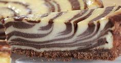 A versão torta do famoso bolo zebra! Você pode inovar nos recheios para obter outras cores e resultados! Esta leva chocolate branco e meio amargo, uma delícia!!!
