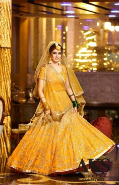 In Indian Weddings, the red bridal lehenga is most loved among brides. For ages, Indian brides have chosen red as the colour of their bridal trousseau. Brides are opting the Mango is the new red for brides this wedding. Pakistani Mehndi Dress, Bridal Mehndi Dresses, Pakistani Wedding Outfits, Indian Gowns Dresses, Indian Bridal Outfits, Bridal Lehenga, Pakistani Dresses, Mehendi, Wedding Dresses