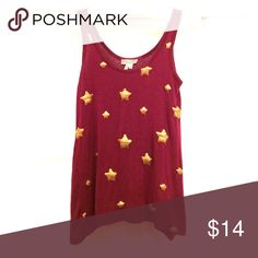 🌟starry maroon top🌟 Maroon colored top with cute sequin stars adorning the front... so cute!!! This top is meant to be loose.... well it looks way better loose👈 Kirra Tops Tank Tops
