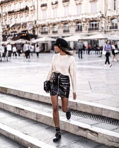 Black skirt leather / white knit sweater / biker boots / hat / New look fashion