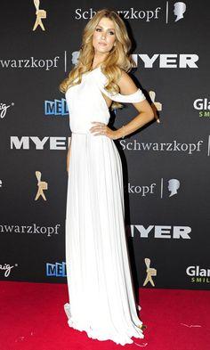 Aussie songstress #Delta Goodrem looks stunning on the red carpet. Hair by Darren Borthwick #celebrity