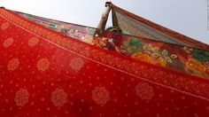 A Hindu pilgrim hangs out saris to dry after taking part in the annual holy dip at Sagar Island on January 14. The event is part of the Makar Sankranti festival, which is celebrated through India, Nepal and Bangladesh. <br />