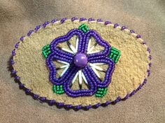 A personal favorite from my Etsy shop https://www.etsy.com/listing/254189386/purple-beaded-barrette