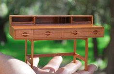 Mid Century Modern Miniature Lovig Desk in cherry scaleThis desk is styled after Jens Quistgaard Lovig desk and is solid cherry. Miniature Furniture, Doll Furniture, Dollhouse Furniture, Modern Furniture, Miniature Rooms, Mid Century Modern Desk, Modern Dollhouse, Diy Dollhouse, Sewing Rooms