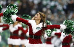 The Jets Flight Crew perform during a game between the New York Jets and the Oakland Raiders at MetLife Stadium on December 8, 2013 in East ...