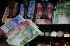Mandela is the first black face to appear on South African money. Siphiwe Sibeko/Reuters