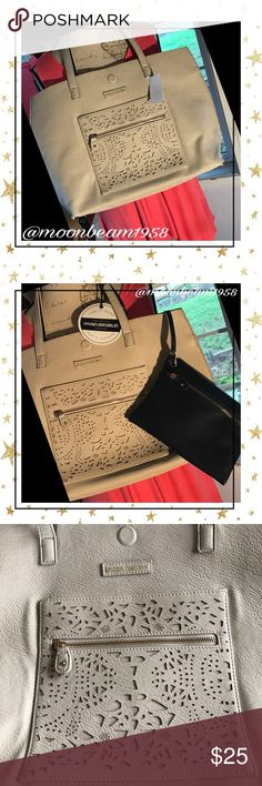 Large large double handed tote🦋💕🐝 Beautiful faux leather tote that is reversible! Comes with dark navy zippered clutch that can be detached or left in bag to store valuables. Reversible color matches clutch as shown in photos. One zippered pocket featured on the  light sand colored side. See photos. This tote is amazing! 💕🦋🐝 Under One Sky Bags Totes