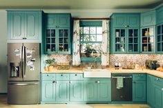When you have versatile appliances that complement any style, you can create a kitchen as bold as you like. These solid turquoise cabinets create a cool, modern canvas to add to.