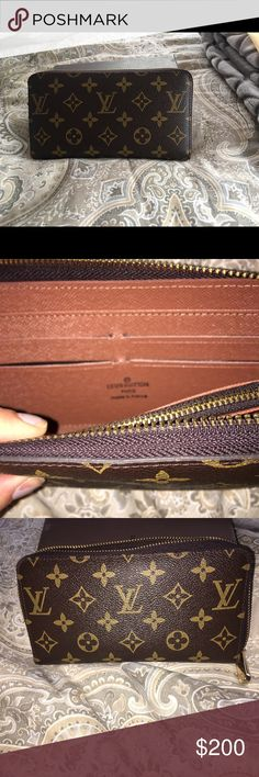 LV zip around wallet LV zip around wallet. Comes with dust bag, and date code stamped inside. Wallet was a gift a couple of years ago. Still has lots of life to it. I replaced it with my new Burberry wallet that matches my new handbag, so there's no need in keeping this one. Bags Wallets