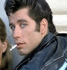 John Travolta only when he was young and without a turkey neck