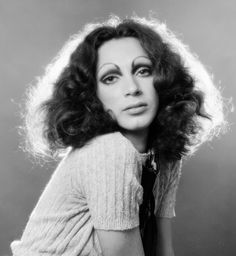 """Holly Woodlawn, December 6 - Woodlawn, so famously immortalized in Lou Reed's """"Walk on the Wild Side,"""" accomplished more than any single verse could convey. A Warhol Superstar and transgender pioneer, she paved the way for countless individuals to come. Transgender, Holly Woodlawn, The Danish Girl, Penny Arcade, Paint Photography, Italian Fashion Designers, Fashion Figures, Musa, Pin Up"""