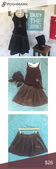 """silence + noise black faux leather skater skirt Faux Leather with gold studs around waist. Hidden Zipper in the back. It's about 17"""" long. Runs on the smaller size of a 10. Great condition. No trades please. Picture one and two are for styling purposes. Ask about pricing and bundle discounts. silence + noise Skirts Mini"""