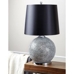 Add a touch of elegance to your space with this Abbyson Living Favorite. A silvertone mosaic glass motif defines this lamp, paired with a black cotton shade.