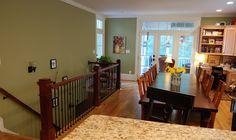 I love this paint color:  Ruskin Green by Sherwin Williams (and we have the same banister!)