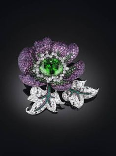 Michelle Ong. Sparkling Lotus bangle in platinum, with white diamonds, green garnets and emeralds