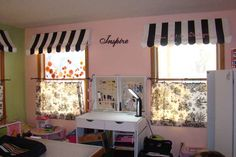 Awnings for curtains! Brilliant. Paris Pink Black and White (toile, stripe) room is actually a scrapbooking room but I think the look would work great for my daughter's Paris bedroom!
