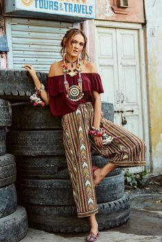 1001 Ideas For Romantic And Chic Boho Style Outfits Patterned Wide Trousers In Burgundy Red And White Yellow And Blue Bohemian Style Clothing Worn By Woman In Dark Red Frilled Top With Chunky Necklaces And Bracelets Style Outfits, Hippie Outfits, Fashion Outfits, Fashion Ideas, Outfit Styles, Travel Outfits, Fashion Guide, Fashion Shoes, Boho Gypsy