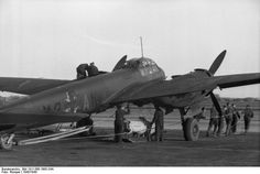A Junkers Ju 88 A-4 being loaded with a bomb, France 1942.
