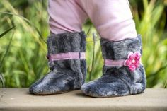 Boots - Grey faux fur with pink crocheted flower and ribbon - girls.  Ships internationally.  Myang boots have non-slip suede soles, fabric uppers, warm fleece lining, soft inner elastic to grip the ankle plus a zip to make for an easy and snug fit. Our boots are so comfortable, they can also be worn as slippers. Available in 6-12 month, 12-18 month and 18-24 month sizes. Please consult the foot chart on our site for sizing. Foot Chart, Faux Fur Boots, Toddler Boots, Ugg Boots, Snug Fit, Pink Flowers, Uggs, Ribbon, Ships