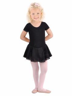 Basic black DanzNmotion short sleeve dance dress by Danshuz. This short sleeved dance dress has a curved neckline and an attached skirt made of georgette. This comfy dress is made of a cotton blend fabric and the front is fully lined. This quality ballet Dance Dresses, Girls Dresses, Short Sleeve Dresses, Dresses With Sleeves, Girls Dancewear, Pink Floral Dress, Comfy Dresses, Chiffon Skirt, Toddler Dress