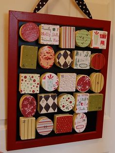 I'm thinking about making an advent calendar similar to this one. I'd like them to be magnets that I can put on the fridge. Boxes from Hobby Lobby, Christmas scrapbook paper, and magnets on the back maybe?