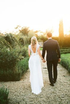 Anna Campbell Bride Lisa wearing the Coco Silk Tulle Dress | Vintage inspired low back detail with bow | Hand embellished with sparkling beading and lace detail | Bohemian boho and romantic wedding dress