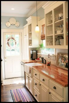 Kittery Blue by Benjamin Moore (now discontinued but very similar to Harbor Fog) Cabinet paint color: Dove White by Benjamin Moore Skies of Parchment – Great before and after photos!!   Related S