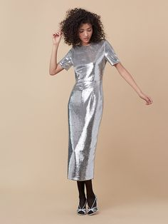 Silver sequins and a back slit complete this polished party dress.